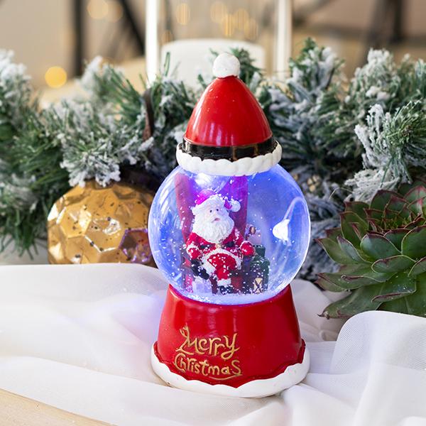 Karácsonyi székben ülő Télapós zenélő hógömb világítás 18 cm